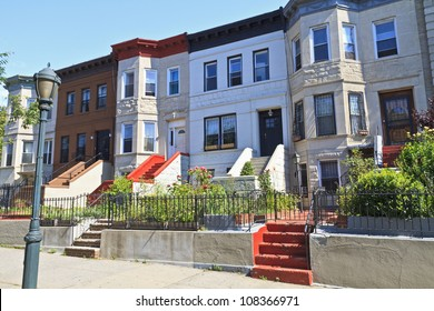 A row of attached apartment buildings on Eastern Parkway in the Crown Heights neighborhood of Brooklyn, NY
