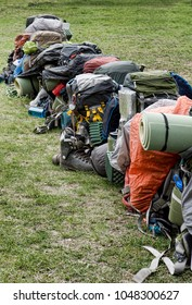 Row of backpacks and gear ready for a group hike on the Chilkoot Trail in Southeast Alaska near Skagway in summer.