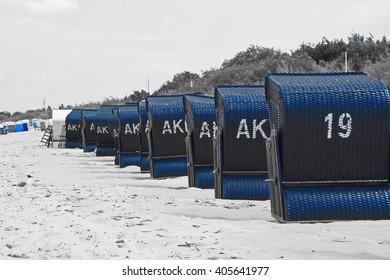 A row of beach chairs on the beach