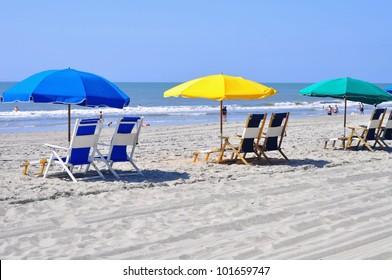 Row of beach chairs waiting for sun bathers