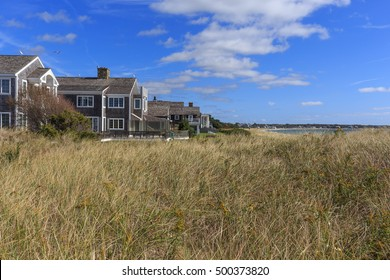 A row of beach front cottages on Cape Cod, Massachusetts.