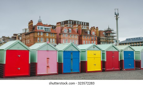 Row of beach huts of Hove in a cloudy day, Brighton, UK