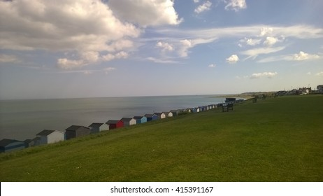 Row of beach huts on a beautiful day