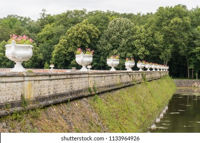Row of Beautiful Large White Garden Pots and Flowers of Château de Chenonceau along the River Cher located in the Loire Valley in France.
