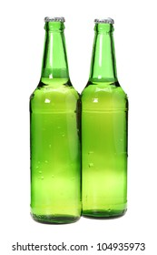 Row of beer bottles on white background