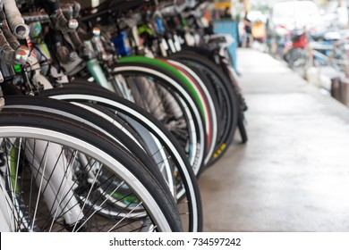 Row of bicycle in bike shop, close up bicycle wheel