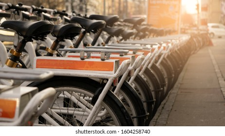 Row of bicycle for rent parking at sidewalk waiting for traveller in the morning, save the earth, alternative transportation, for your health.
