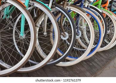row of bicycle wheels, bicycle wheels