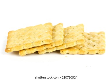 Row of biscuits isolated on white background