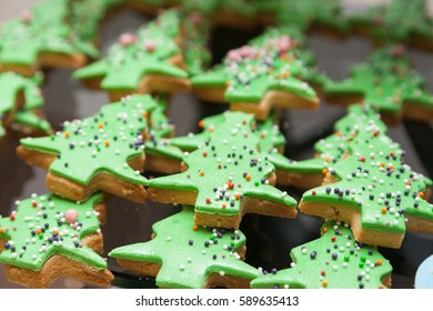 Row of biscuits in shape of Christmas tree with selective focus