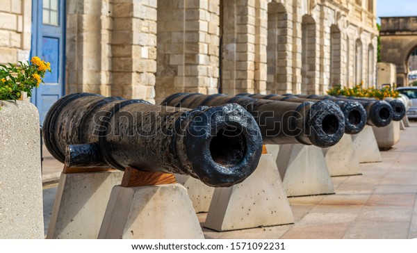 row-black-cannons-along-waterfront-600w-