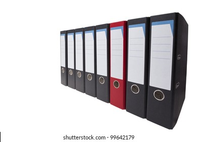 a row of black ringbinders with one different ringbinder