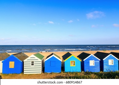 Row of blue beach huts at Southwold beach, UK