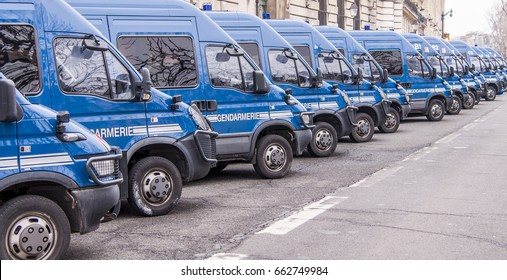 A row of blue police or gendarmerie vans  parked outside the Paris Police Prefecture on the Ile de la Cite in Paris France.