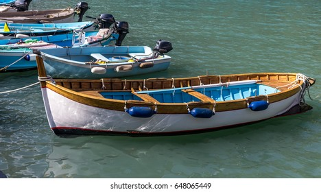 Row boat on the clear water