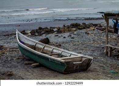 Row boat standing alone in a beach Ecuador