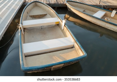row boat in the water port top view