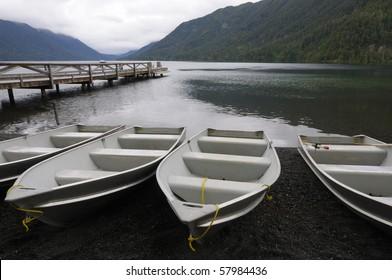 Row boats at dock, Lake Crescent, Washington State