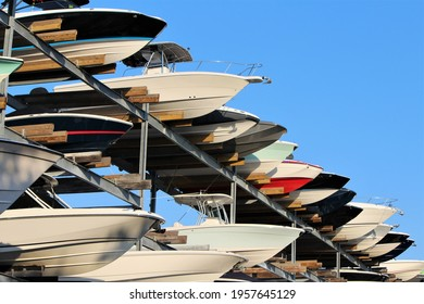 Row of boats sticking out of a boat storage rack in a marina. Maritime storage boat yard