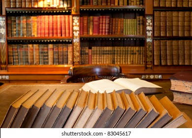 Row of book in front of desk in classic library