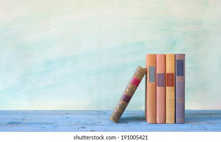 row of books, grungy background free copy space