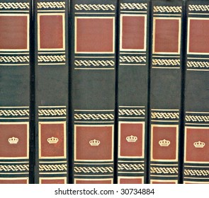 Row of books isolated on white background
