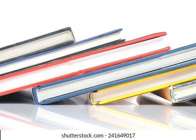 Row of books on white background