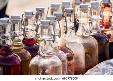 row of bottles with home made wine