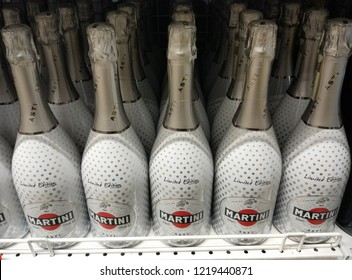 row of bottles of Martini Asti Dolce champagne on the counter in a store in Kiev, Ukraine, 01 November 2018.