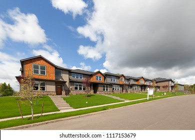 Row of brand new townhomes for sale in North America suburban neighborhood