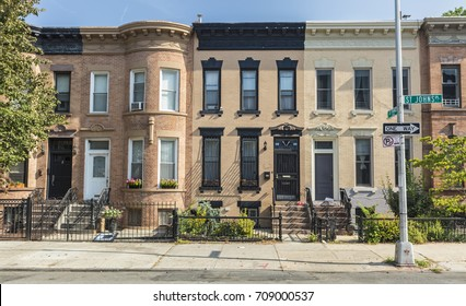 A row of brick apartment buildings on the corner of St. Johns and St. Francis Place in the Crown Heights Neighborhood of Brooklyn, New York