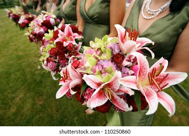 Row of Bridesmaids with Iris Wedding Bouquets