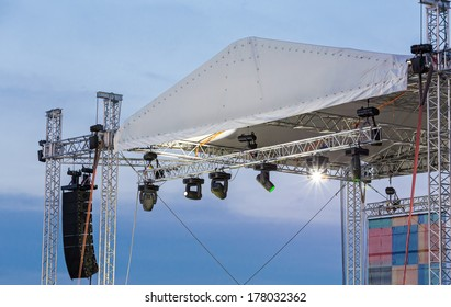Row of bright spotlights on an empty stage before the concert