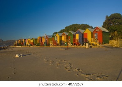 A row of brightly colored beach huts. Taken at St James, South Africa tken at sunrise