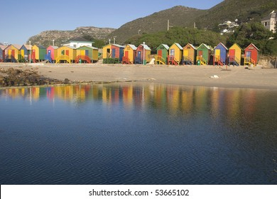 Row of brightly colored beach huts at St James. Cape Town, South Africa
