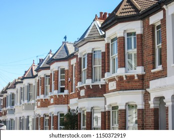 A row of British red brick terraced houses