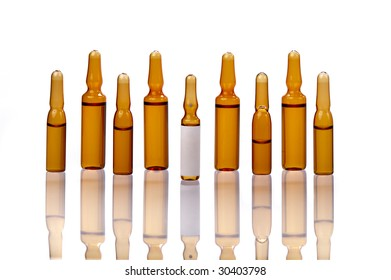 row of brown medical ampoules  on white background