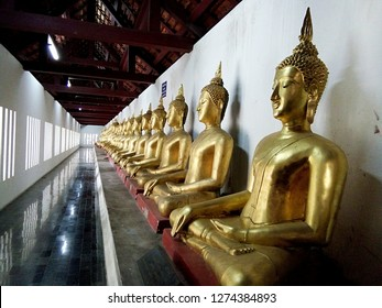 The row of Buddha image in Wat Phra Sri Rattana Mahathat temple , Phitsanulok Thailand.
