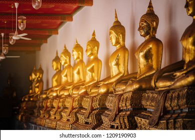 A row of Buddha images inside Thai Buddhist Temple