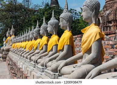 Row of Buddha statues at Wat Yai Chai Mongkhon temple in Ayutthaya, Thailand