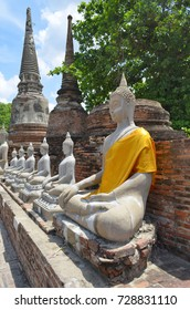 Row of Buddha statues at Wat Yai Chai Mongkhon in Ayutthaya, Thailand