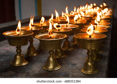 Row of burning candles in a chinese buddhist temple