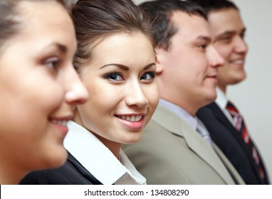 Row of business people with focus on confident businesswoman