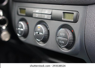 Row of buttons of a car airco