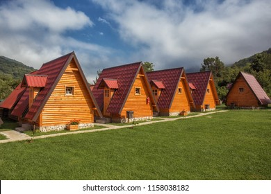 A row of cabins on a campground.