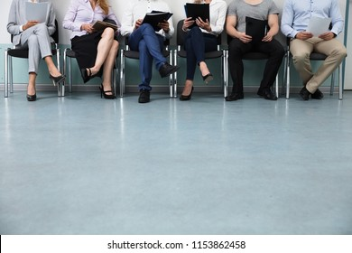 Row Of Candidates Sitting On Chair For Job Interview