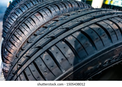 Row of car dirty tires at warehouse in tire store