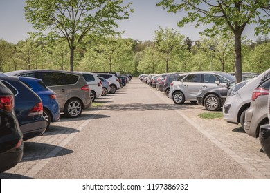 row of cars in car parking lot, outdoor parking