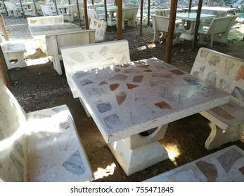 Row of cement table locally made in Thailand.