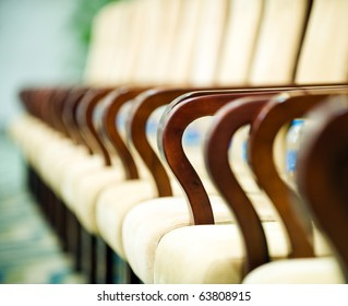 Row of chairs in boardroom.  Macro with extremely shallow depth of field.